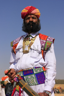 Indian man in traditional dress taking part in Mr Desert competition, Jaisalmer, India