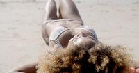 Young Woman Sunbathing In Bikini
