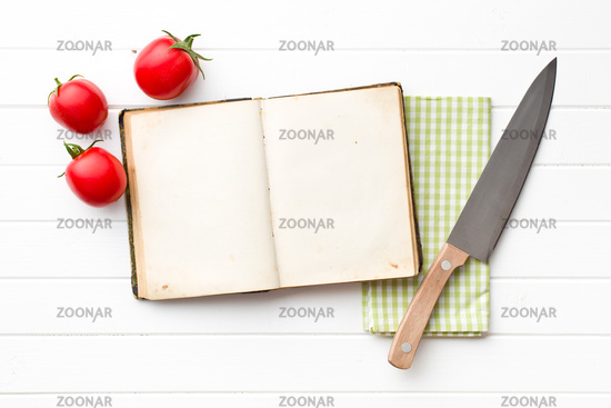 cookbook and tomatoes