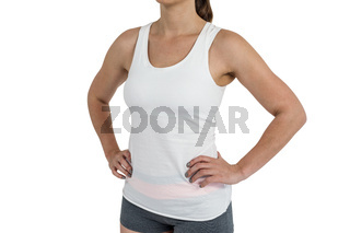 Female athlete standing on white background