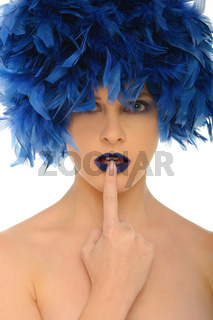 woman with blue feathers lips and open eyes