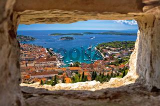 Hvar bay aerial view through stone window