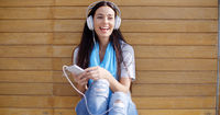 Happy woman enjoying her music