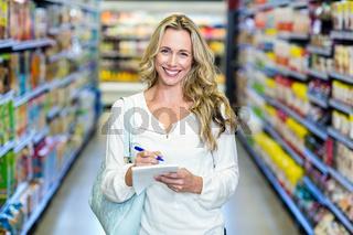 Blonde woman checking list