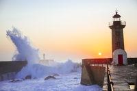 Lighthouse Felgueirasin Porto with wave splash at sunset