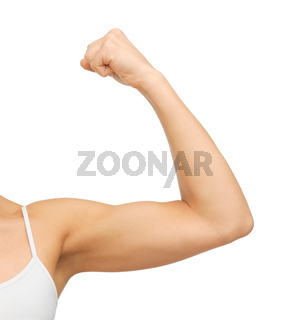 sporty woman flexing her biceps