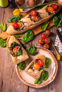 farmer baguette filled with egg, bacon and spinach
