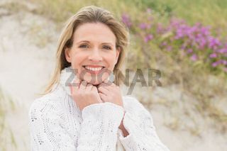 Woman smiling near the sandy hill