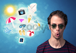 Happy joyful man with sunglasses looking at summer icons