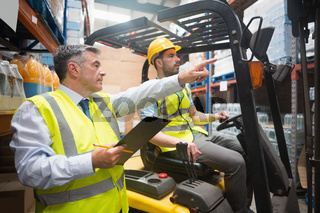 Forklift driver talking with his manager