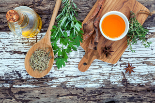 Assortment of herbs rosemary ,thyme,sage and parsley set up with wooden background concept for international cuisine.