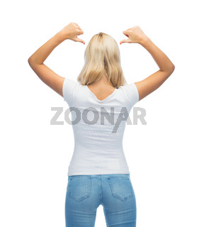 rear view of young woman in blank white t-shirt