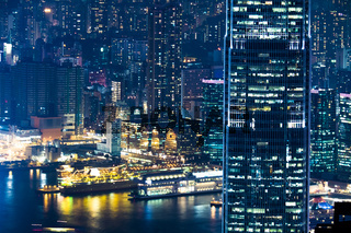 Abstract futuristic night cityscape. Hong Kong aerial view