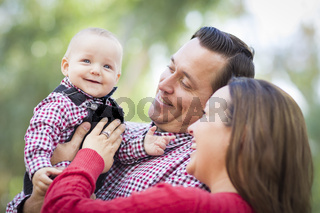 Little Baby Boy Having Fun With Mother and Father Outdoors