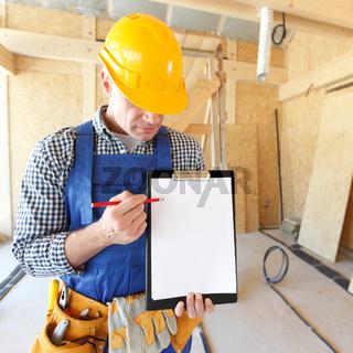 Foreman pointing at white folder