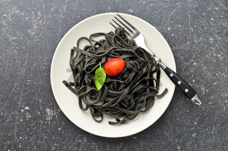 cooked black noodles with squid sepia ink