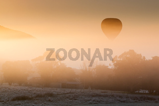 Hot Air Balloon Rises Thru The Mist