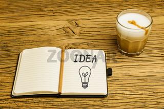Concept idea lightbulb notebook with pencil
