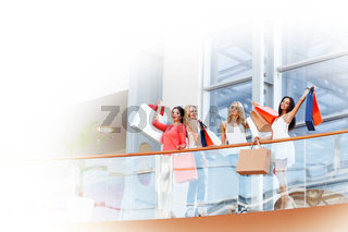 women standing on balcony