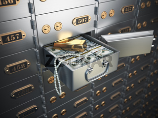 Open safe deposit box with money, jewels and golden ingot.