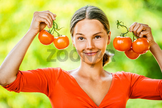 young woman in red blouse with tomato
