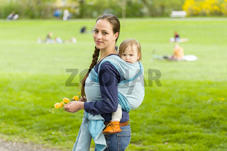 mother and child in baby sling