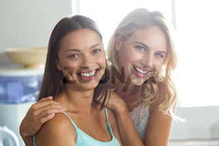 Smiling young women spending leisure time at home