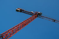 Red crane with blue sky on background