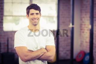Portrait of smiling muscular man looking at camera