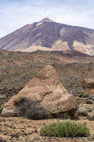 Triangular rock and view of mount Teide from along the siete canadas trail in the las canadas del teide national park