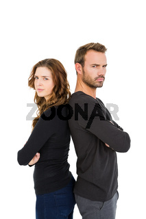 Depressed couple standing back to back