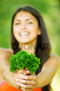 portrait cheerful woman hands herbs