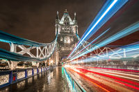 Fast cars crossing TowerBridge at night, London, United Kingdom