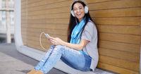 Pretty trendy young woman enjoying her music