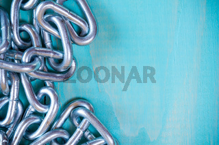 Metal chain on nice wooden background
