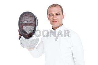 Swordsman holding fencing mask