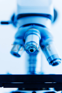 Microscope objective lens in modern laboratory interior