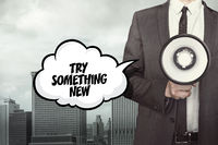 Try something new text on speech bubble with businessman and megaphone