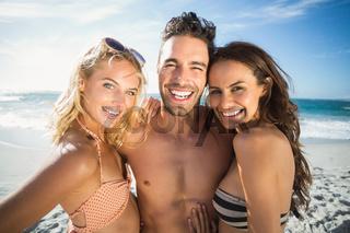 Happy friends enjoying moment on the beach