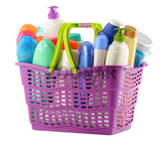 Plastic shopping basket with body care and beauty products isolated on white
