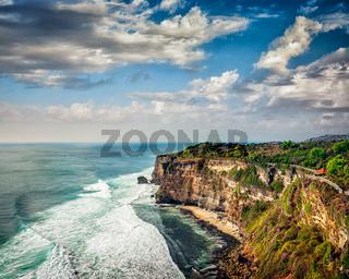 Cliff in ocean on sunset