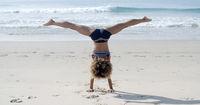 Girl Doing A Handstand On A Beach