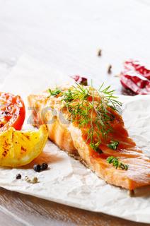 Fried salmon fillet rustic serving