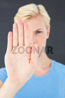 Stern woman gesturing with her hand
