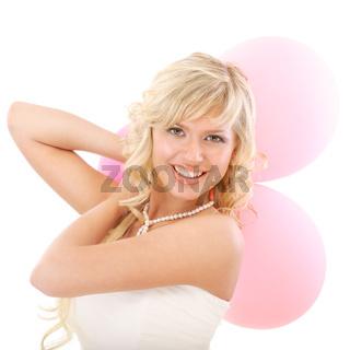 Lovely girl holds three inflatable spheres