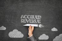 Accrued revenue concept on blackboard with paper plane