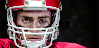 Composite image of portrait of focused american football player wearing his helmet