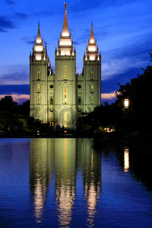 Temple of The Church of Jesus Christ of Latter-day Saints reflected in the pool at night, Salt Lake City, Utah