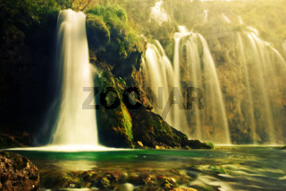 Waterfall in forest. Crystal clear water.
