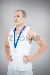 Composite image of close-up of athlete with olympic medal